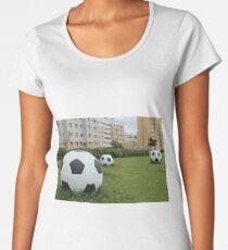 soccer balls on the green lawn Women's Premium T-Shirt