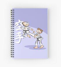 Karate boy jumps spectacularly Spiral Notebook