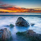 Rocks and fiery sky by Ralph Goldsmith