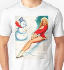 Pin up blond girl with skates on ice, in company of amazed snowman T-Shirt