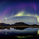 Northern light over the pond by Frank Olsen