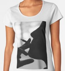 Silhouetted profile of a young man smoking. Model release available  Women's Premium T-Shirt