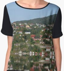 Reflection in the water of the Norwegian fjord of colorful houses in the forest on a hill Women's Chiffon Top