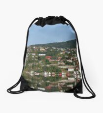 Reflection in the water of the Norwegian fjord of colorful houses in the forest on a hill Drawstring Bag