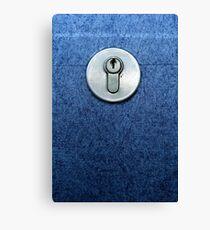 Keyhole on a blue door Canvas Print