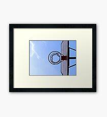 Basketball court and a clear blue sky Framed Print