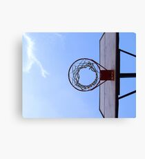 Basketball court and a clear blue sky Canvas Print