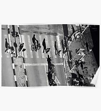 Elevated view of a city crossroads with zebra crossing and pedestrians crossing a street.with large shadows cast by the people.  Poster