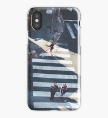 Elevated view of a city crossroads with zebra crossing and pedestrians crossing a street.with large shadows cast by the people.  iPhone Case/Skin