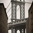 Empire State Building through arch of Manhattan Bridge by Alan Copson