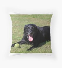 labrador retriever laying with toy black Throw Pillow