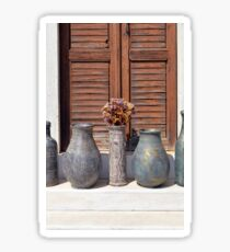 Ancient Greek vases by a window with wood shutters  Sticker