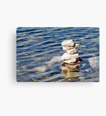 Norway trolls reflected in water - pyramids, laid out of stones Canvas Print