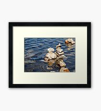 Norway trolls reflected in water - pyramids, laid out of stones Framed Print