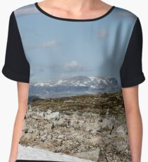 snow glade in the stone tundra against the backdrop of mountains and cloudy skies, norway, Scandinavia Women's Chiffon Top