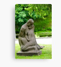 Stone statue of a loving couple at the National Opera Gardens, Riga, Latvia  Canvas Print