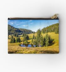 pine trees near lake on the meadow Studio Pouch