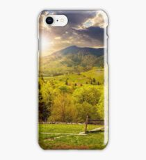 fence on hillside meadow in mountain at sunset iPhone Case/Skin