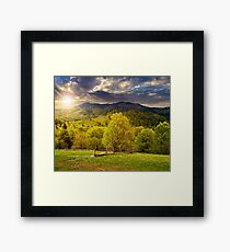 fence on hillside meadow in mountain at sunset Framed Print