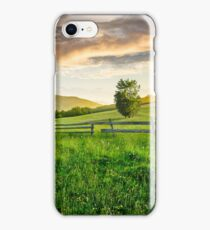 fence on hillside meadow in mountain at sunrise iPhone Case/Skin