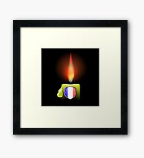Burning Candle and Shield Isolated on Dark Background Framed Print