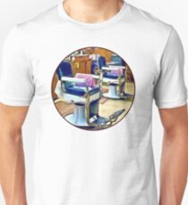 Two Barber Chairs With Pink Striped Barber Capes Unisex T-Shirt