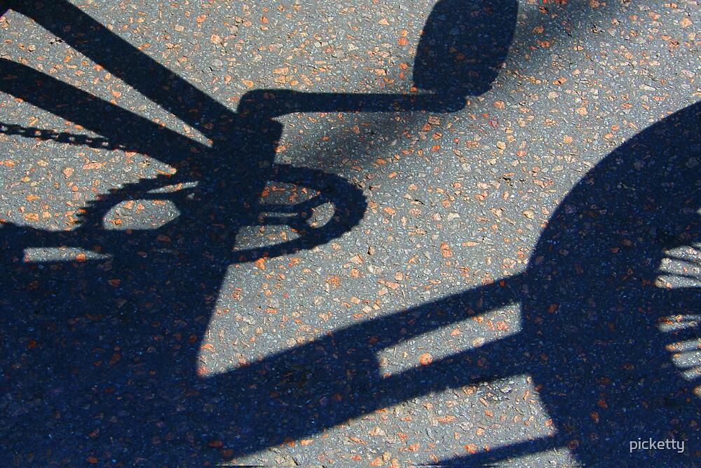 bike shadow by picketty