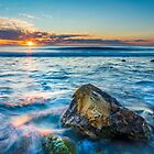 Sunrise sea and a rock by Ralph Goldsmith