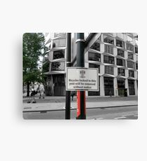City of London notice bicycles locked to this post Canvas Print