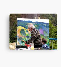 Artist at work with assistant ......John Rigby.  Canvas Print