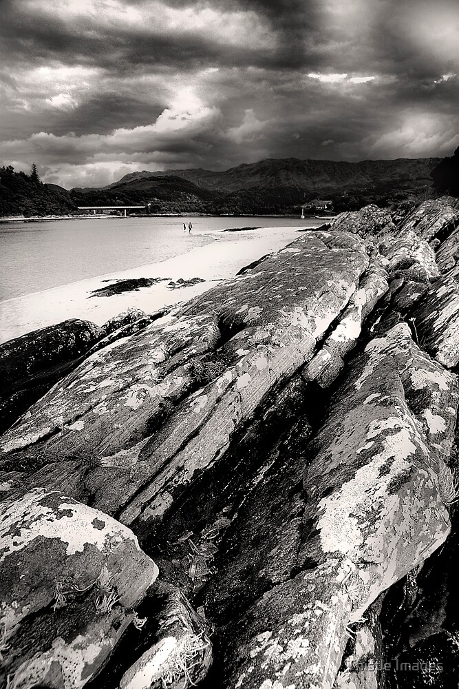 On the rocks at Morar by Thistle Images