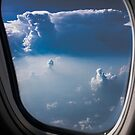 blue sky through aeroplane window  by Jessica Sharmin