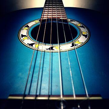 Blue acoustic guitar by junpinzon