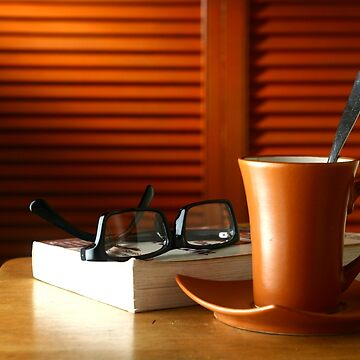 Book, eyeglasses and coffee on a table by junpinzon