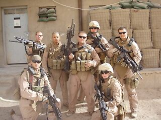 Roy with his squad in Fallujah, Iraq by Laura Puglia