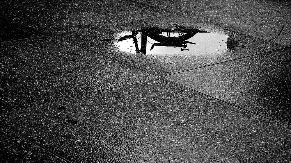 cycle in rain pool by ragman
