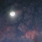 Glowing Moon on the night sky through pink clouds by Victoria Avvacumova