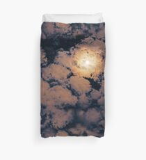 Full moon through purple clouds Duvet Cover