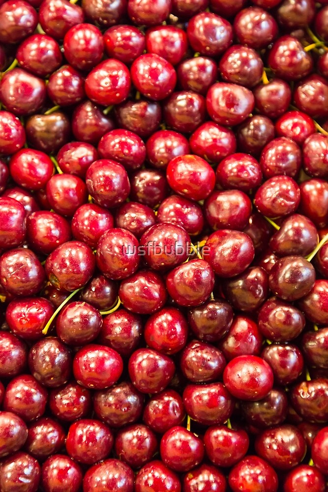 Many cherries at a market stall by wsfbubble