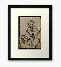 Evangelist portrait of St. Matthew in a medieval manuscript  Framed Print