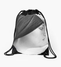The best way to turn a woman's head is to tell her she has a beautiful profile.   Drawstring Bag