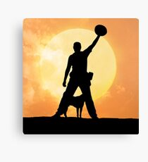 Male silhouette on background amazing sunset Canvas Print