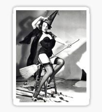 Pin up woman posing in studio, in witch costume Sticker