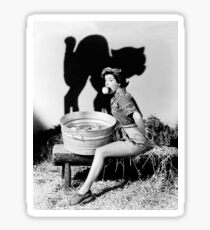 Young woman is bobbing for apples, with black cat shadow Sticker