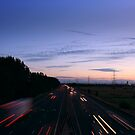taillights and sunsets by Jon Baxter