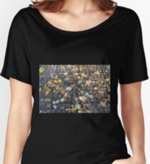 Yellow and orange fallen autumn leaves on the sidewalk  Women's Relaxed Fit T-Shirt
