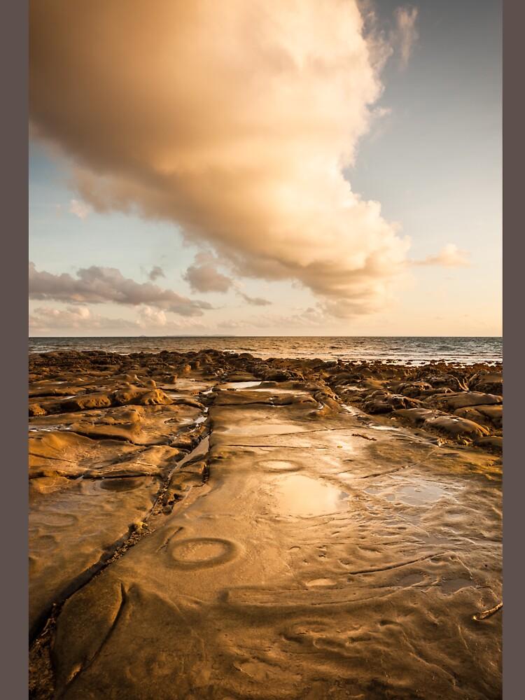 Rocky beach at tip of Borneo by Juhku