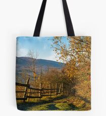wooden fence near forest in mountains Tote Bag