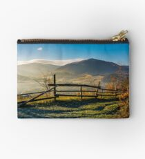 wooden fence near forest in mountains Studio Pouch