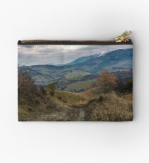 dirt road through mountainous countryside Studio Pouch